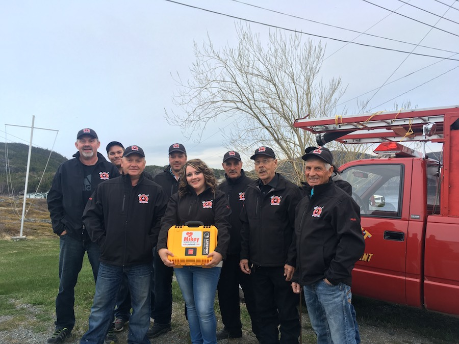 Volunteer fire fighters with their new MIKEY DEFIBRILLATOR in Paquet, Newfoundland and Labrador